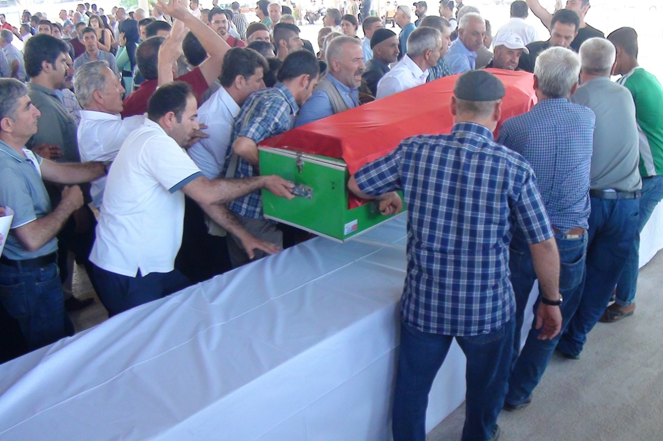 The bodies of those killed in Suruc are delivered to their families